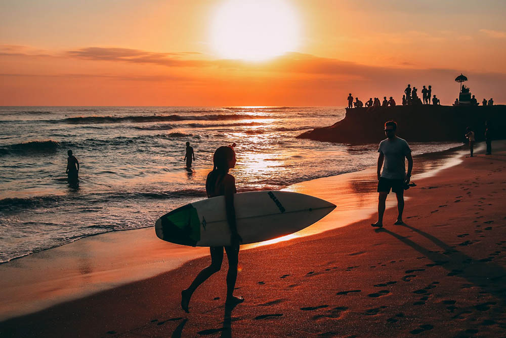 Digital nomad surfing in Bali during the sunset. Canggu life