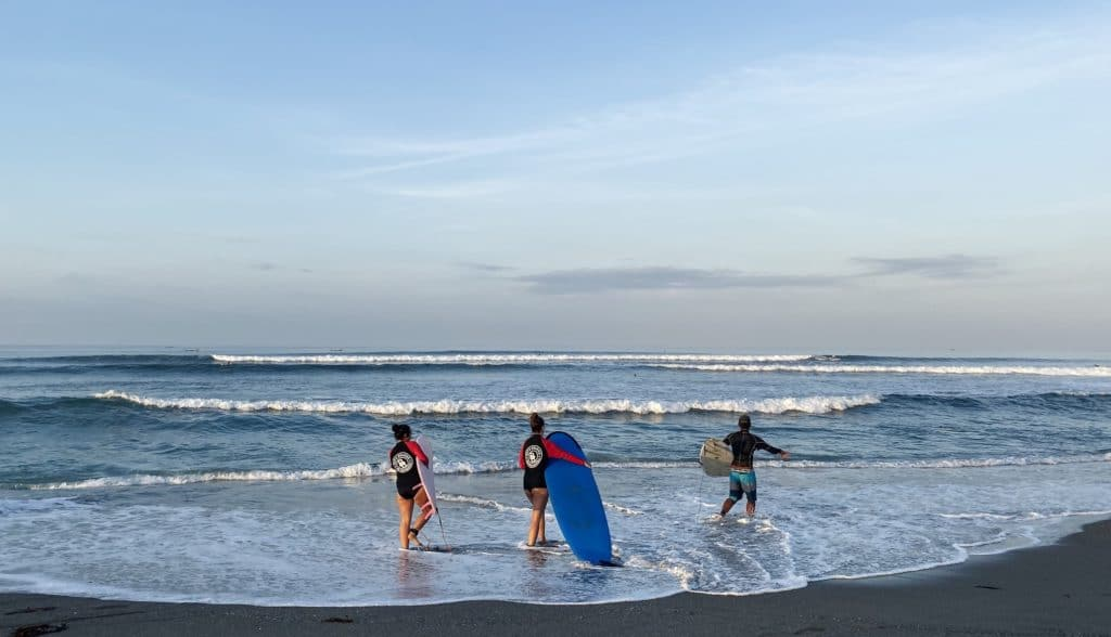 Surfing in Canggu, Bali at Batu balong beach