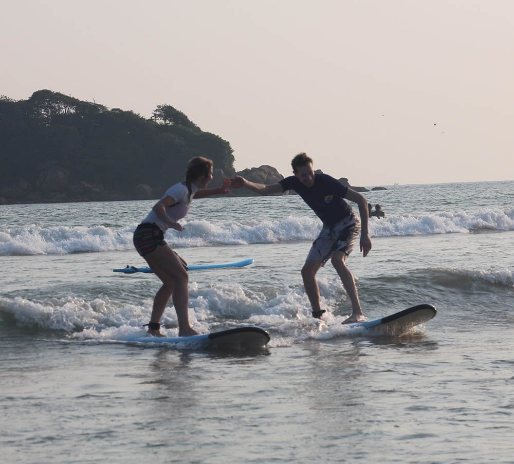 Digital nomads learning to surf