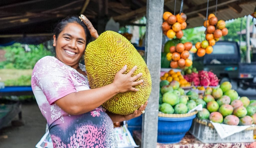 Balinese woman with a fruit